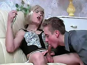 Crossdresser guy enjoys blowjob with teen boy