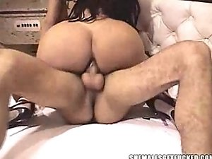 Brunette shemale riding on his fucker