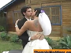 Tattooed tranny bride with her guy outdoors