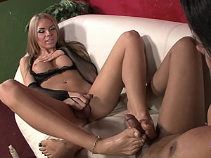 Shemales Ashley George and Sunshyne Monroe in footjob scene